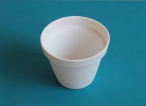 le pot à fleur en porcelaine de Limoges produit par Jean-Louis PUIVIF